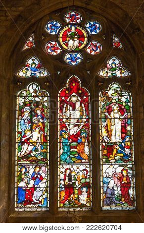 HARBURY, ENGLAND - AUGUST 10, 2012: A stained glass window in the parish church of All Saints in Harbury in Warwickshire, England.