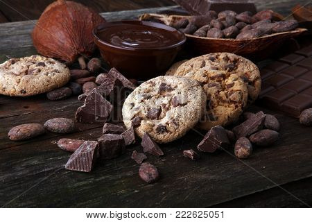 Chocolate cookies on wooden table. Chocolate chip cookies shot.