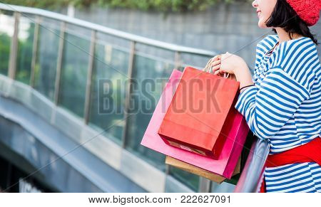 Shopping gift and present on holiday for New Year and Birthday party.Teenager women holding a shopping bag.
