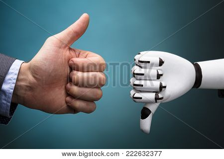 Businessperson And Robot Showing Thumb Up And Thumb Down Sign On Turquoise Background