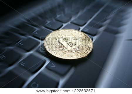 Gold Bitcoin On Computer Keyboard With Zoom Burst High Quality Stock Photo