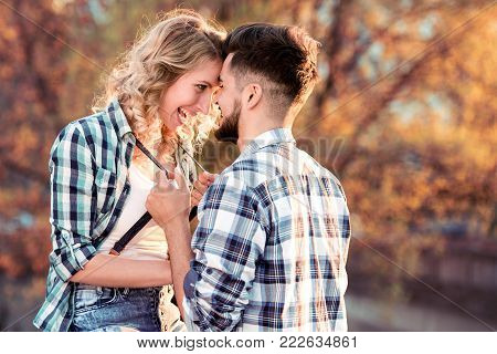 Smiling Couple In Love Outdoors With Bike.