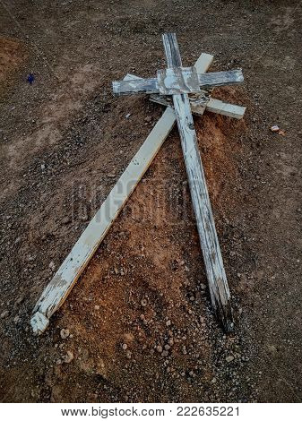 Old western wood grave cross, unmarked, close up image in cemetery in Arizona