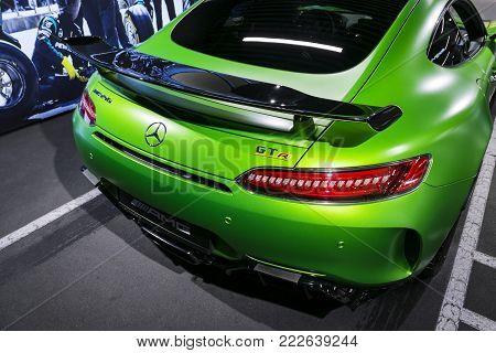 Sankt-Petersburg, Russia, January 12, 2018 : Green Mercedes-Benz AMG GTR 2018 V8 Bi-turbo exterior details, Headlight. Back view. Car exterior details
