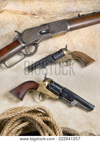 Old antique western cowboy rifle and pistols.