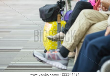 Motion Blur Of Legs Of Passengers Waiting To Board Flights