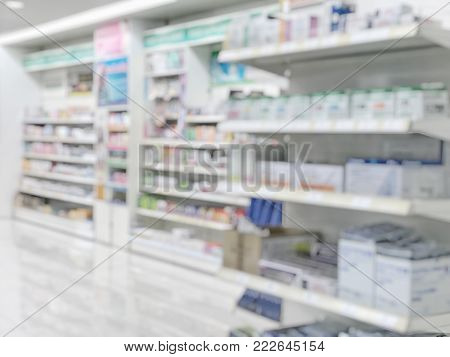 Pharmacy Store Blur Background With Drug Shelf And Blurry Pharmaceutical Products And Cosmetic Suppl
