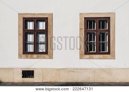 Budapest, Hungary - August 12, 2017:  Two windows of residential building in the old city of Buda in Budapest.