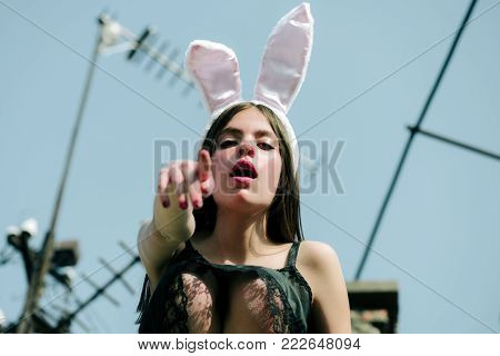 Easter Woman Wearing Rosy Bunny Ears On Blue Sky