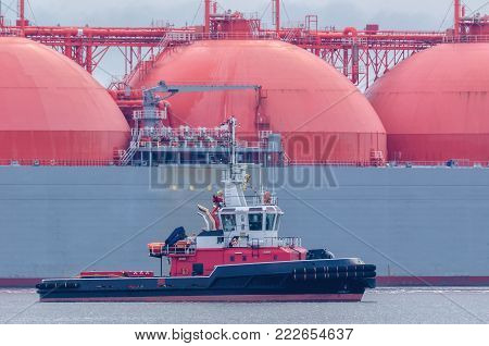 FIREBOAT AND TANKER-  Gas Carrier safety secured by fireboat at the gas terminal in the port of Swinoujscie (Poland)