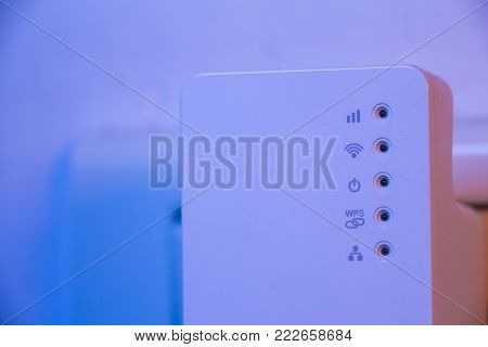 Closeup On Wifi Repeater Wps Button And Ethernet Socket