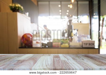 Wooden Tabletop On Blurred Restaurant Or Coffee Shop Background, Can Be Used For Display Or Montage