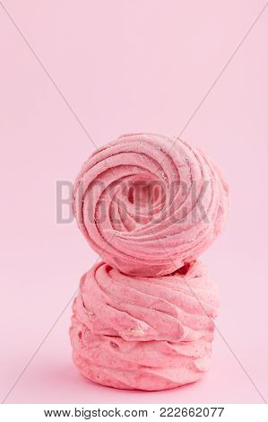 Pink homemade zephyr or marshmallow on pink background. Marshmallow, Meringue, Zephyr