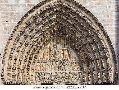 Architectural details of the catholic cathedral Notre-Dame de Paris. Built in French Gothic architecture, Notre-Dame's facade showing details of the Portal of the Last Judgment. Paris, France