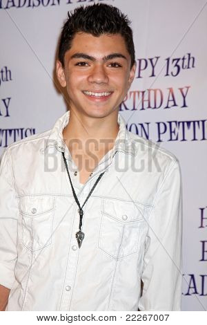 LOS ANGELES - JUL 31:  Adam Irigoyen arriving at the13th Birthday Party for Madison Pettis at Eden on July 31, 2011 in Los Angeles, CA