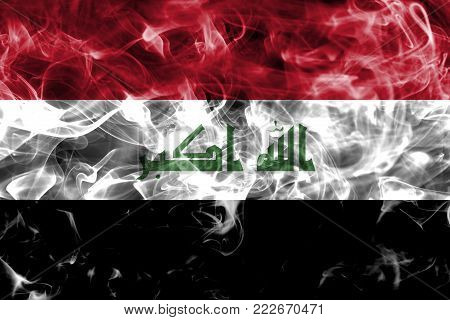 Iraq smoke flag isolated on a black background