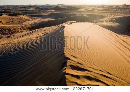 Sand dunesduring sunset in the desert in the United Arab Emirates.
