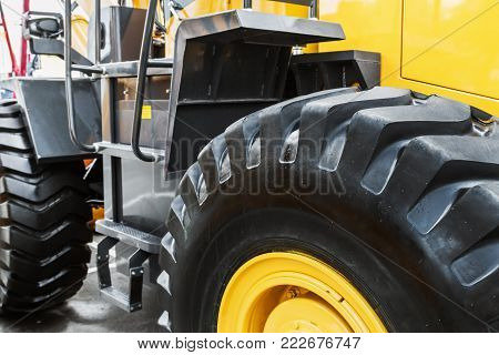 big tyre of a tractor or bulldozer. The details of the construction or repair of equipment