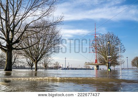 DUISBURG , GERMANY - JANUARY 08 2017 : The river Rhine is flooding the Muehlenweide in Ruhrort
