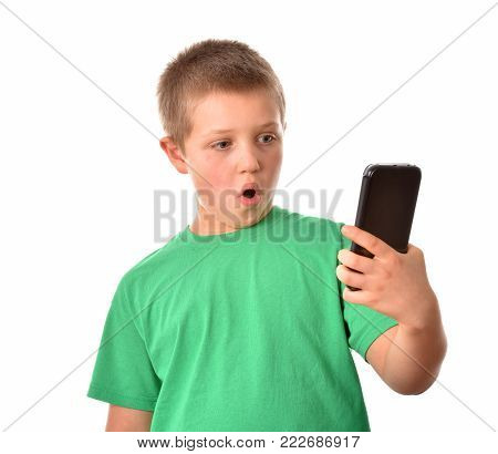 Boy with mobile phone. A good mood. A boy on a white background.