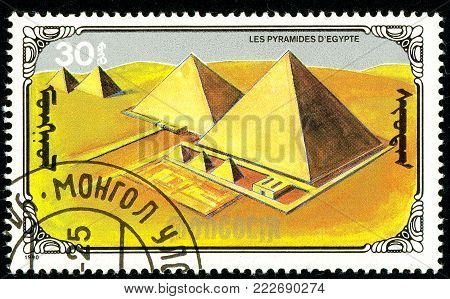 Ukraine - circa 2018: A postage stamp printed in Mongolia show Pyramids of Egypt. Series: 7 Wonders of the Ancient World. Circa 1990.