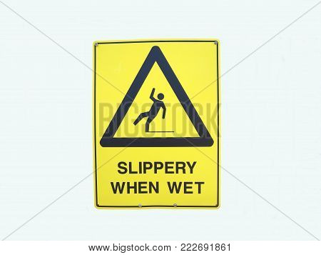 A Warning Sign Depicting Someone Falling Over Due To It Being Slippery When Wet