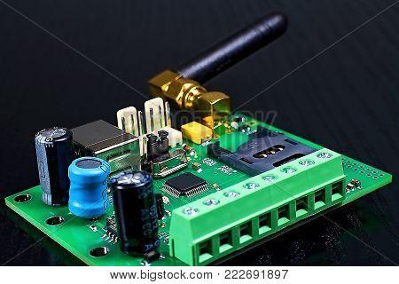 GSM communicator hardware with GSM antenna. Wireless communication options.