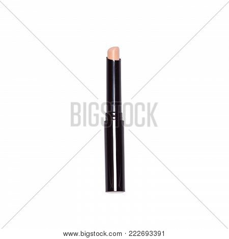 Makeup concealer stick isolated on white background. Make-up corrector pencil, close-up