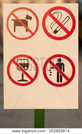 Prohibiting signs: no dog, not smoking, not drink, without garbage