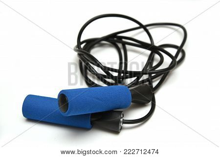 Skipping blue rope on a white background