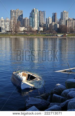 English Bay Shipwreck, Vancouver vertical. A sunken sailboat the day after a storm hits Vancouver, British Columbia.
