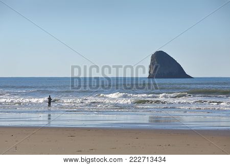 Oregon Coast Surf Fishing, Pyramid Rock. Surf fishing on the Oregon Coast. Pyramid Rock near Cape Meares in the background.