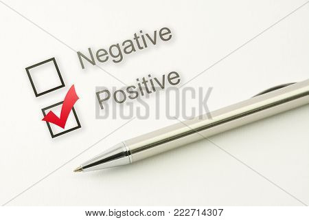 questionnaire: positive choice or negative, check box with a pen on paper background closeup