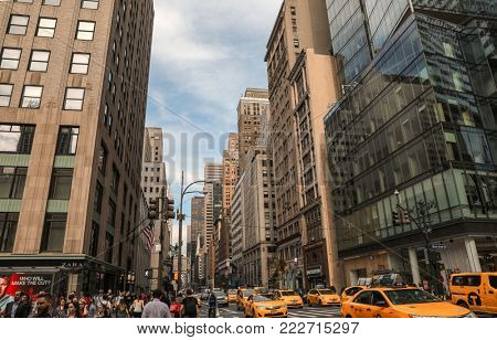NEW YORK - okober 05 2017: Yellow taxis rides on 5th Avenue  in New York, USA. 5th Avenue is a central road of Manhattan, the most expensive shops and apartmens situated here.