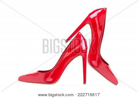 Lacquered red shoes. High Heel Shoes. Elegant red high-heeled patent leather shoes.