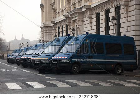 PARIS, FRANCE - DECEMBER 20, 2017:  French police forces (Gendarmerie) vans waiting in line near their headquarters for Downtown Paris. French Gendarmerie is a military component with jurisdiction in civil law enforcement.