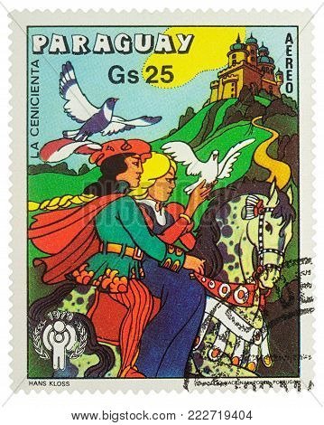 Moscow, Russia - January 19, 2018: A stamp printed in Paraguay shows Cinderella and Prince - scene from a fairy tale, series