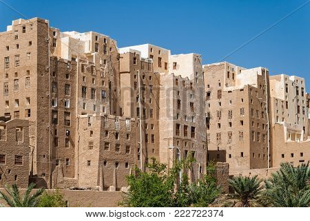 SHIBAM, YEMEN - MAY 8, 2007: Multi-storey buildings made from mud in Shibam, a UNESCO World Heritage Site in Yemen on May 8, 2007. Among other arabic countries, in 2012 Yemen became a site of civil conflicts, which still continue.