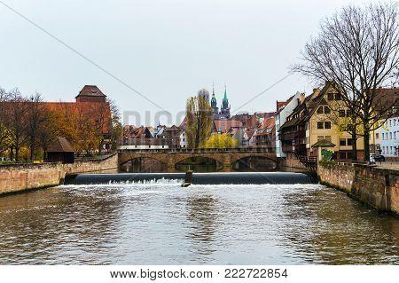 NUREMBERG - GERMANY - NOVEMBER 15, 2017: Landscape of the Pegnitz river in autumn time. Nuremberg. Bavaria. Germany.