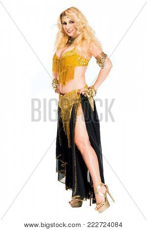 Portrait of beautiful blonde woman belly dancer isolated on white