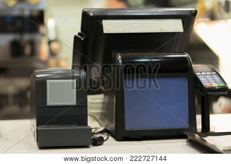 cash desk and credit card reader or swiper at the famous cafe