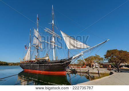 Wooden vessel docks at Mystic Seaport connecticut