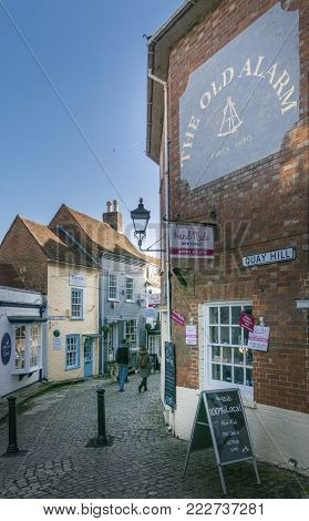 LYMINGTON, NEW FOREST, HAMPSHIRE, UK, JANUARY 2018 - View of  Quay Hill  and Quay Street in the town of Lymington, New Forest, Hampshire, UK