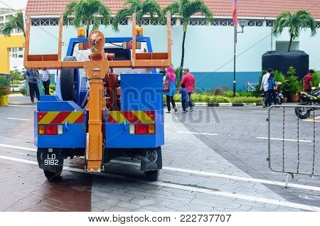 Labuan,Malaysia-Jan 18,2018:City ​​enforcement tow truck in street of Labuan island,Malaysia.It is a truck used to move disabled,improperly parked,impounded,or otherwise indisposed motor vehicles.