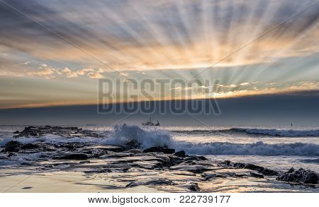 Beautiful sun rays during sunrise at Jersey Shore. Avon-by-the-sea, New Jersey