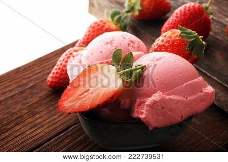 Strawberry ice cream scoop, scooped with a ice spoon