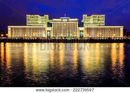 Night december building of Ministry of Defence, Moscow, Russia. Illuminated with sparks christmas Moscow river