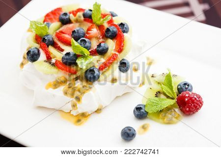 Pavlova, a home made cake from layers of meringue, whipped cream, and fresh berries