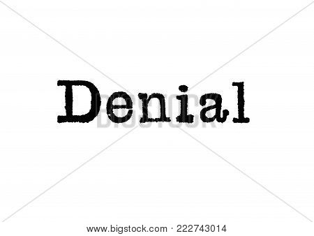 The word Denial from a typewriter on a white background