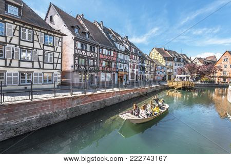 Colmar, France - May 2017: Tourists On A Boat Trip In Little Venice Quarter
